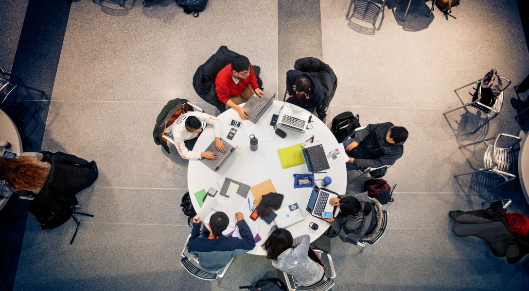 Students gather to study in the Physical Sciences Building atrium.
