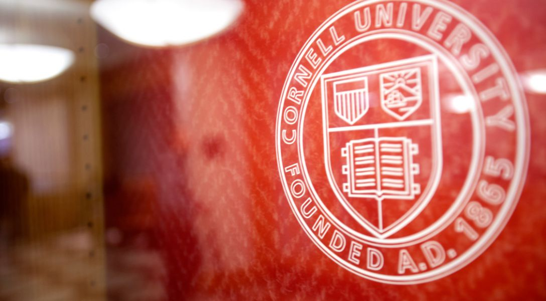 The Cornell logo within Sage Hall