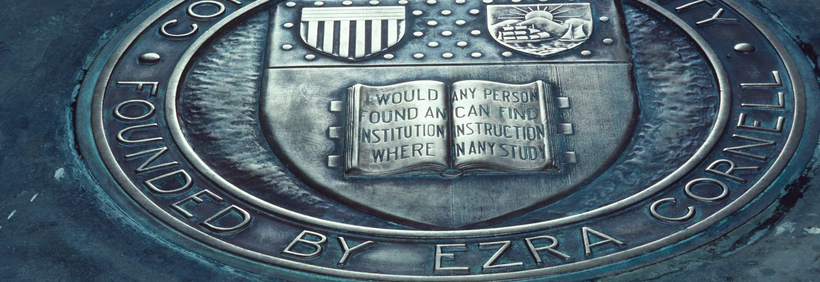 "A closeup of the book portion of the Cornell Seal at Myron Taylor Hall: ""I would found an institution where any person can find instruction in any study."""
